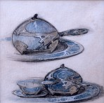 Plate with ornate tea pot and cup and saucer