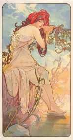 A woman with long dark hair and bare shoulders wears large red poppies in her hair and leans against a grapevine