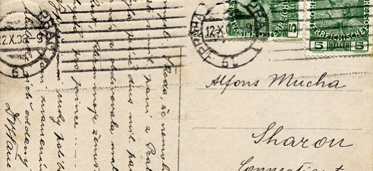 Verso of a postcard with Czech stamps and handwriting in Czech