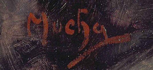 Signature in red paint on a dark background