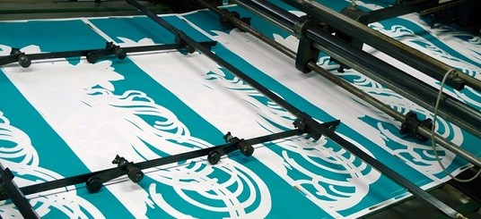 "Printing press printing exhibition poster for ""Mucha, Manga, Mystery"" presented at the Bellerive Museum in Zurich in 2013"