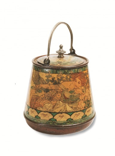 Round biscuit tin with a metal handle decorated with a female figure and a decorative floral motif