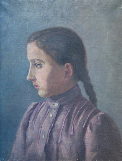 Head and shoulders of a girl seen in profile with dark hair in a plait and a mauve pleated and high-collared dress sitting against a blue background